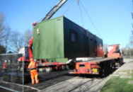 Container unit home being delivered 2