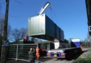 Container unit home being delivered 6